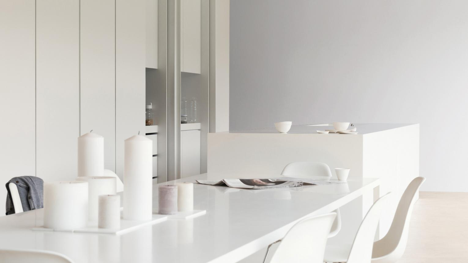 Add warmth to a minimalist white kitchen with paint accents of pale silvery grey.